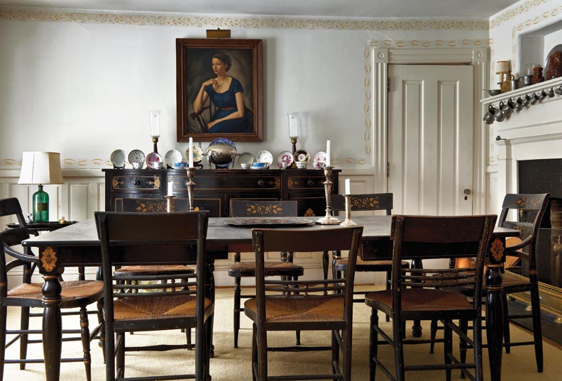 Paint-stenciled decoration dates to colonial days, and remained a thrifty alternative to wallpaper through the 19th century. The top-of-wall border, and another that outlines the dining room's millwork, are typical.