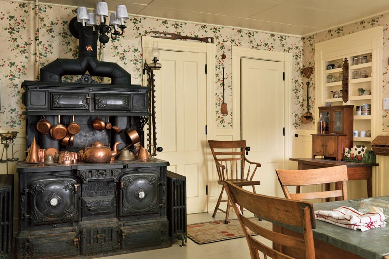 A focal point of the kitchen is THE huge cast-iron Magee cooking stove installed during the 1908 renovation. The Country rock-maple chairs are a 20th-century take on a fan-back Windsor.