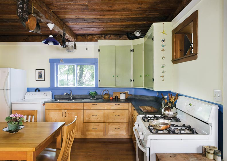 New stock cabinets and a soapstone countertop were cost-effective replacements.