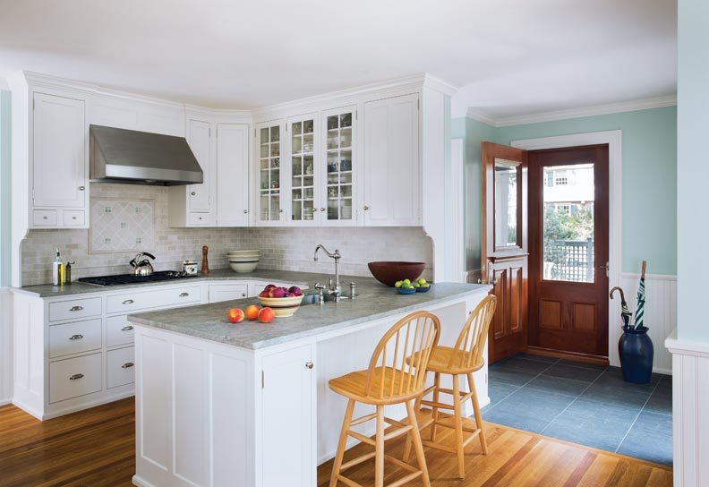 Designer Jeff Peavey worked with Betsy and Chris Sands to create their ideal kitchen. The back door was custom-made and is a replica of the couple's front door.