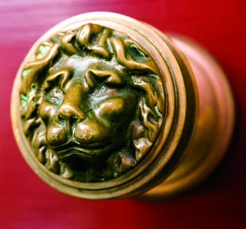 A Victorian-era doorknob boasts a lion's face on the handle.