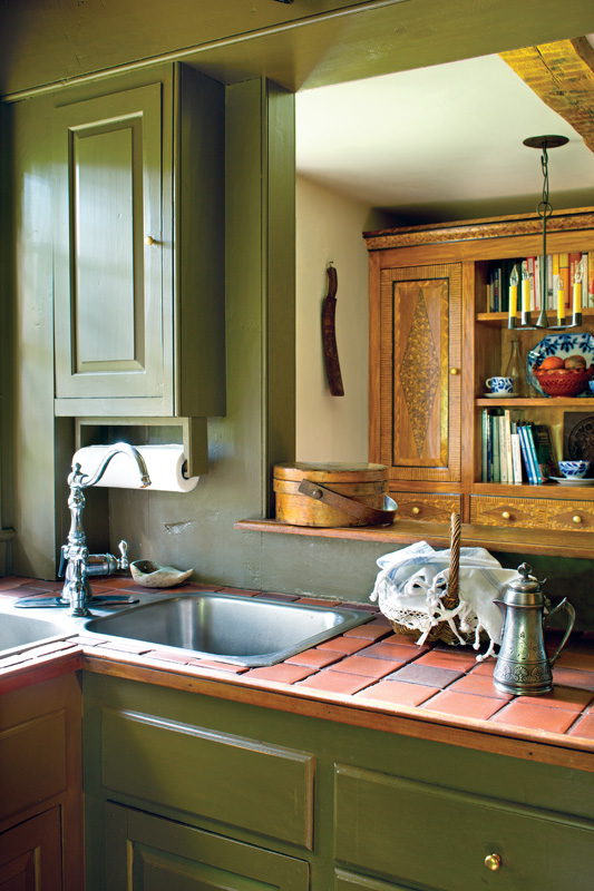 Visible from the pass-through is the grain-painted cupboard.