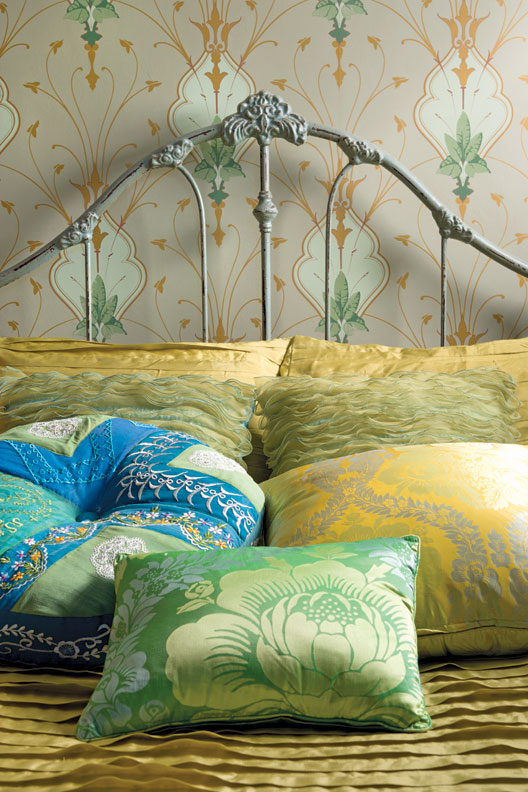 Art Nouveau wallpaper from Switzerland (now discontinued) dresses up a tiny bedroom.