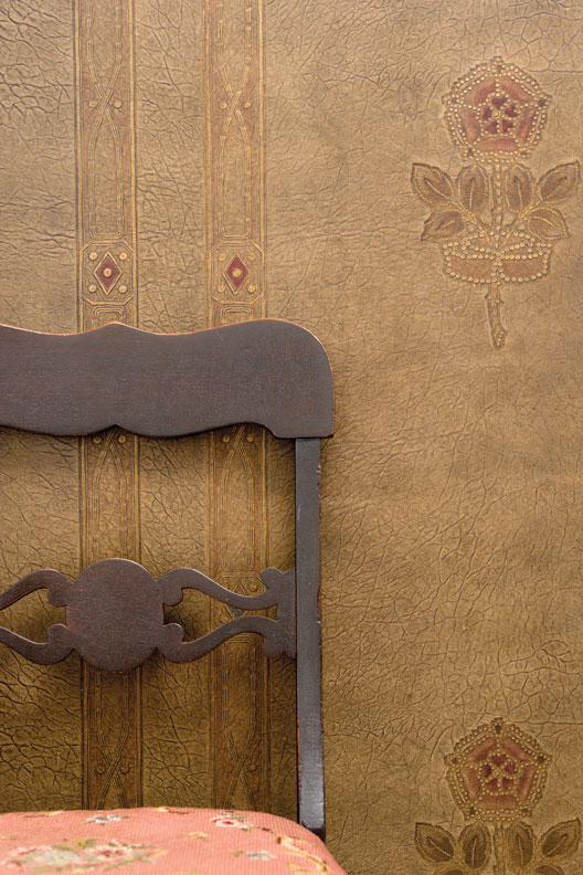 Colonial Revival-era lincrusta, a wallcovering meant to simulate tooled leather.