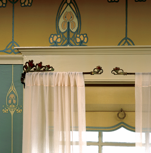 C.J. Hurley created a contrasting scheme with a Swedish blue-green paper accented with pink irises and yellow cartouches against a handpainted frieze. The ivory trim creates harmony. Note the subtle coordination of the window shade.