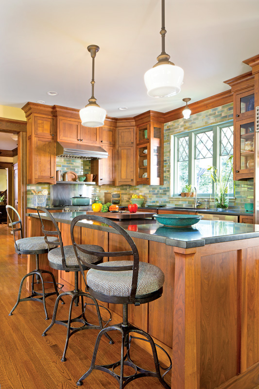 Walnut cabinets reach to the ceiling.