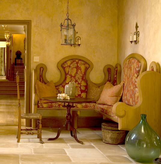 Welcoming guests in the hall: a corner banquette inspired by Colonial Revivalist Wallace Nutting.