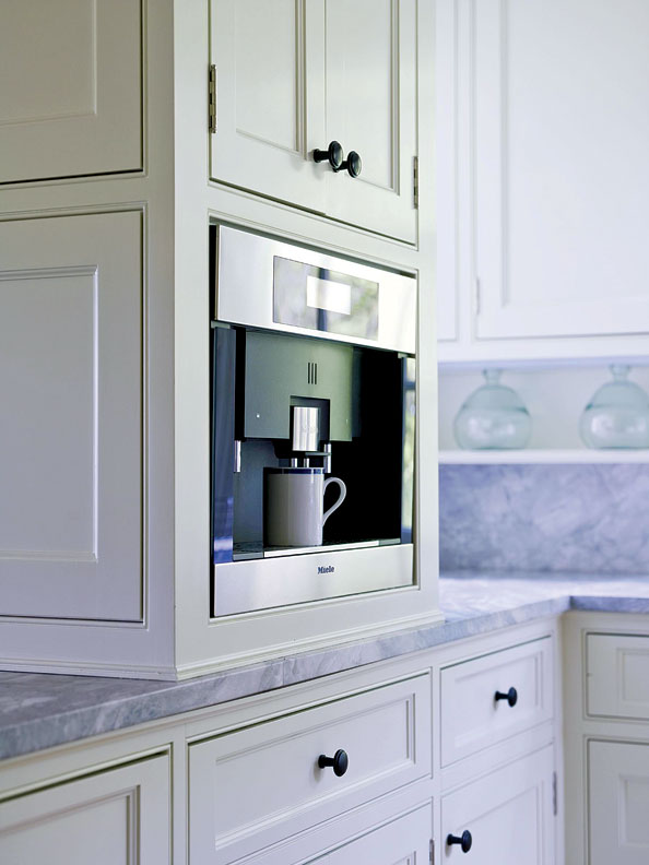 The kitchen is equipped with all the latest gadgets, such as this espresso machine.