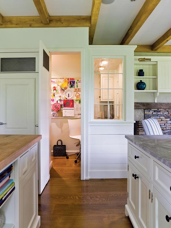 A small home office is located just off the kitchen.