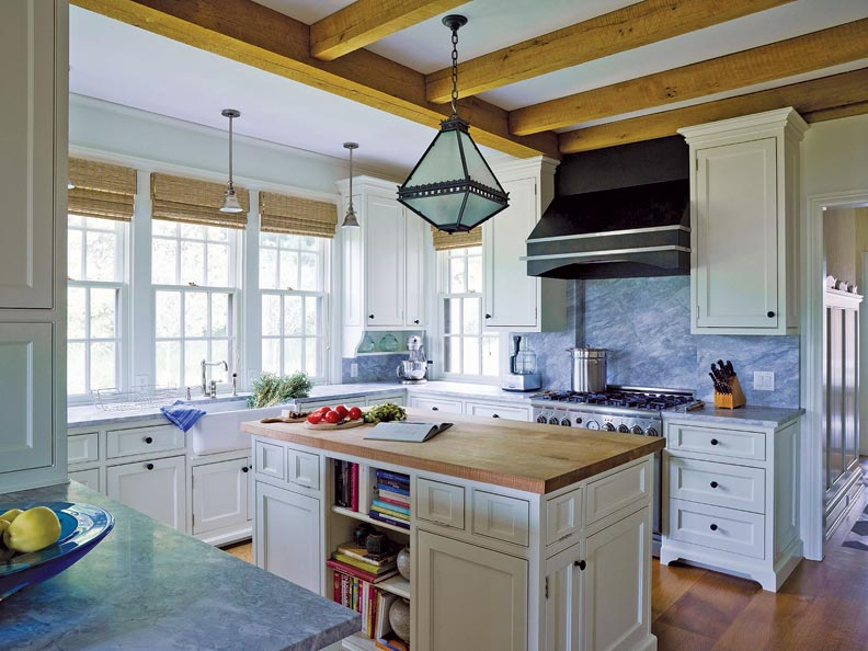 Rough-sawn oak timbered beams and wide-plank flooring give the kitchen its rustic look.