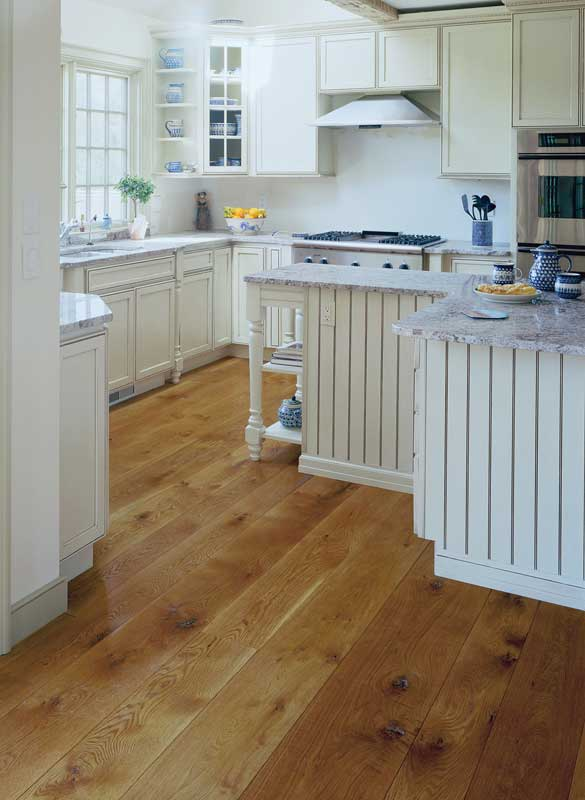 White oak takes well to staining; this kitchen floor is from Carlisle Wide Plank Floors.