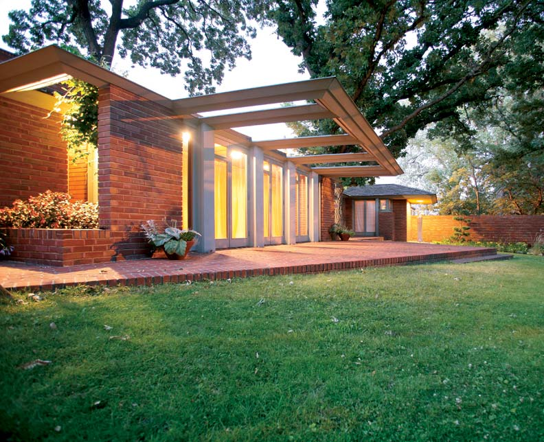 A prominent feature of Frank Lloyd Wright's Willey house, designed for a Minnesota professor and his wife, is an expansive cantilevered trellis, which appears to hover over a row of French doors. Wright envisioned wisteria vines covering the trellis to help frame the view and blur the line between the indoors and out.