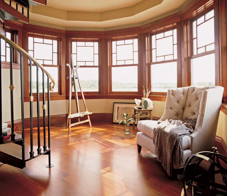 Double-hungs with a Queen Anne top sash are the highlight of this turret room.