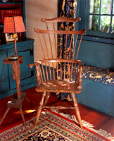 A comb-back chair from the late 1700's is one of the treasures in an 18th century stone colonial in Kingston, New York.