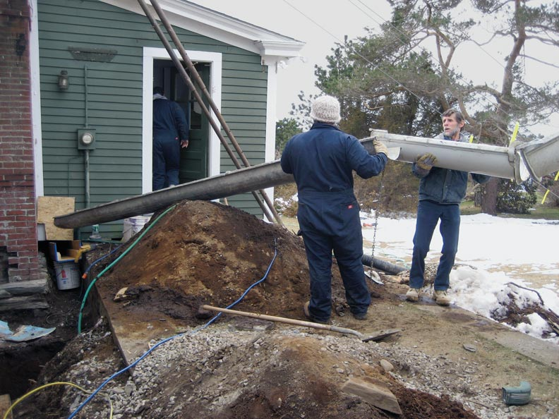 The team poured new concrete footings to stabilize the poorly constructed original stone foundation.