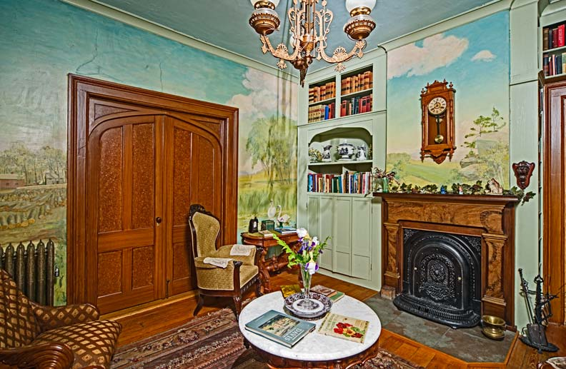 Baraboo scenes grace a mural dating to 1932—so yellowed, the couple considered wallpapering over it. They discovered that denatured alcohol removed the protective shellac, revealing the colors.
