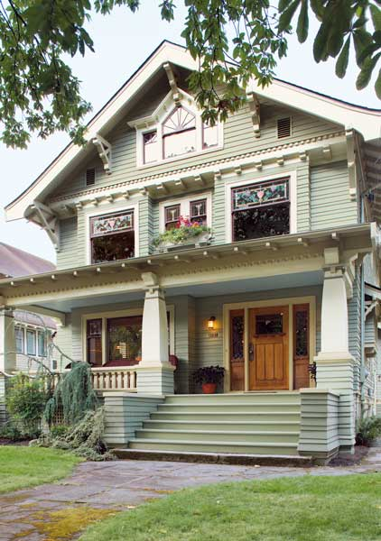 """With its gabled """"bungalow"""" roof and porch, and lots of artistic details, this Foursquare is a looker."""