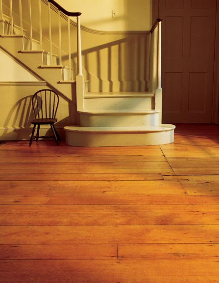 The mellow patina of an old floor is the result of decades of aging and judicious care. This antique floor and staircase were installed in an addition at Gore Place in Waltham, Massachusetts, in the early 20th century.