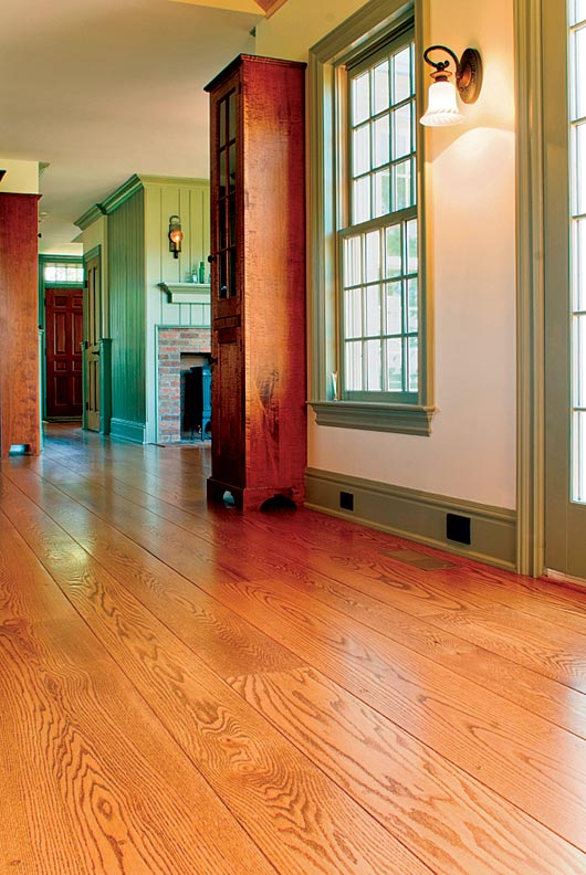 Using wide-plank flooring can help a new addition blend with an old house.