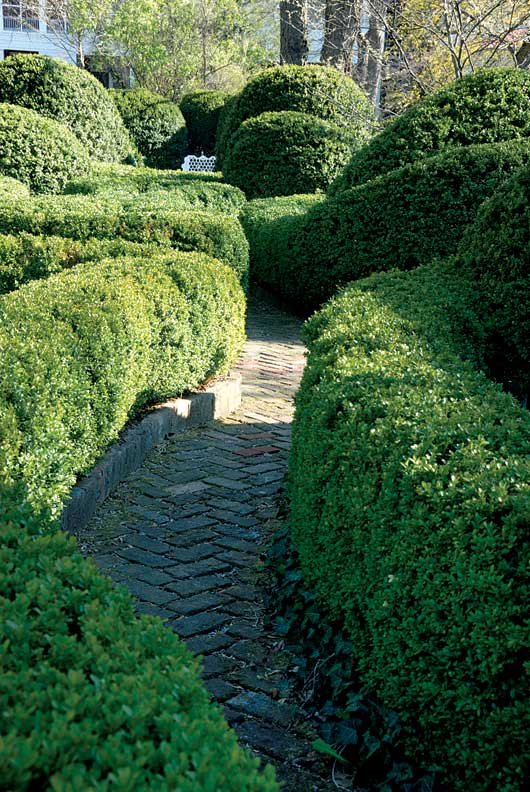 Herringbone brick paths wind through the bow-knot garden.