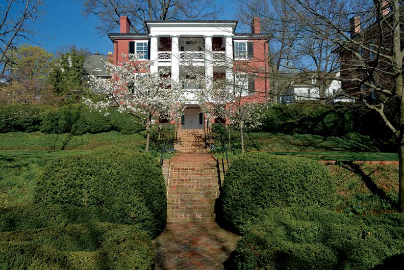 President Woodrow Wilson's 1846 Greek Revival birthplace sits on a hill overlooking the town of Staunton, Virginia. A brick terrace, added in the 1960s by landscape architect Ralph Griswold, leads from the house down to the gardens.