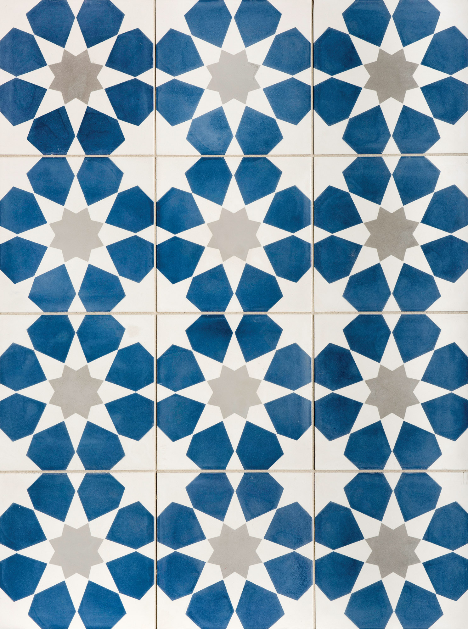Indigo and gray star patterned tiles from Walker Zanger.